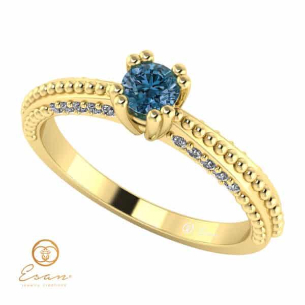 Inel de logodna din aur cu diamant albastru si diamante incolore ES98